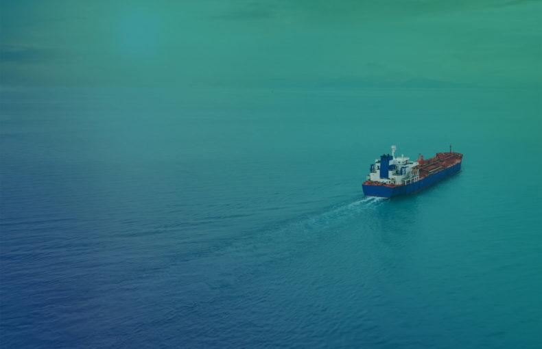 Aerial view of a container cargo ship sailing over calm sea